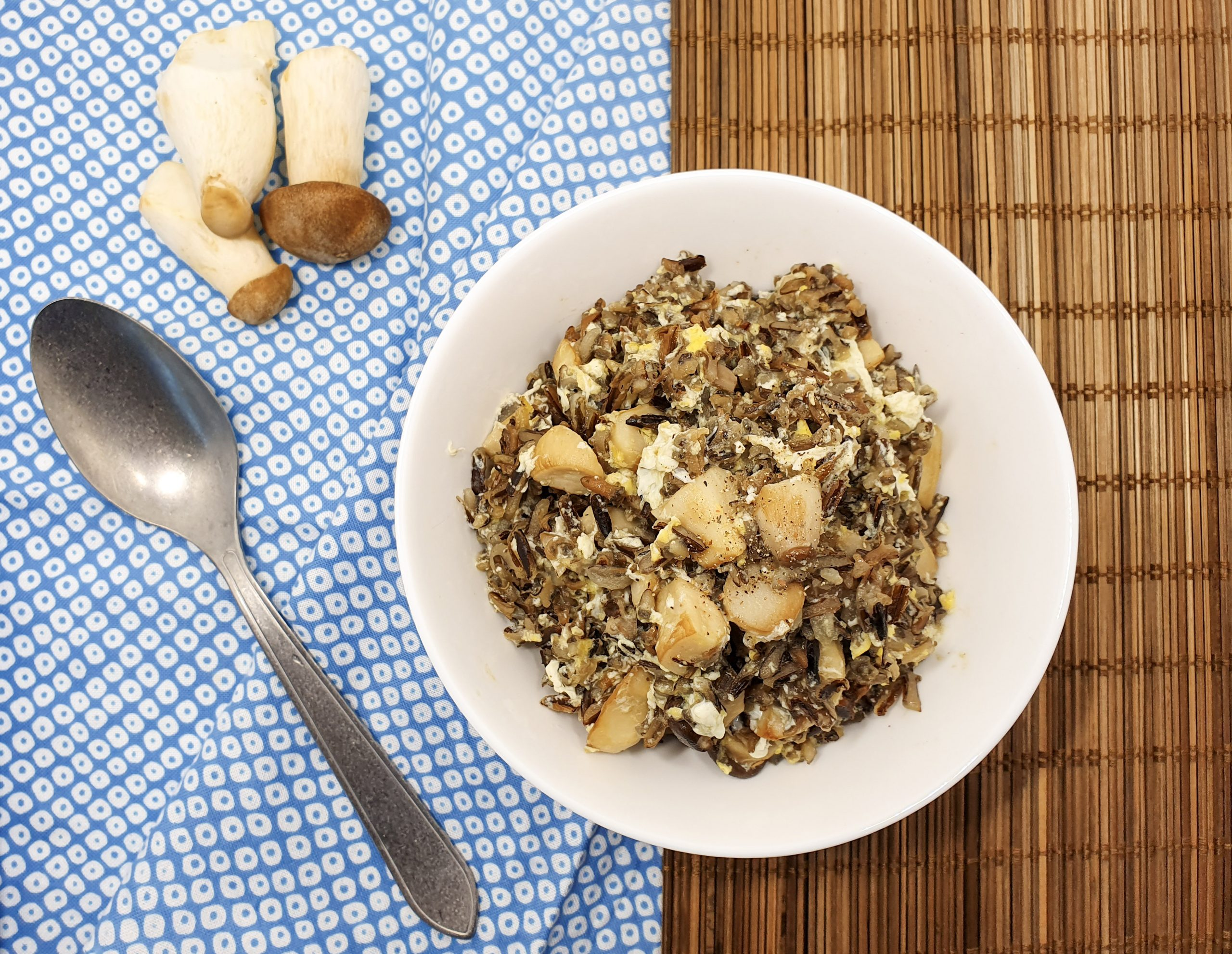 Bowl with mushroom and wild rice with an egg