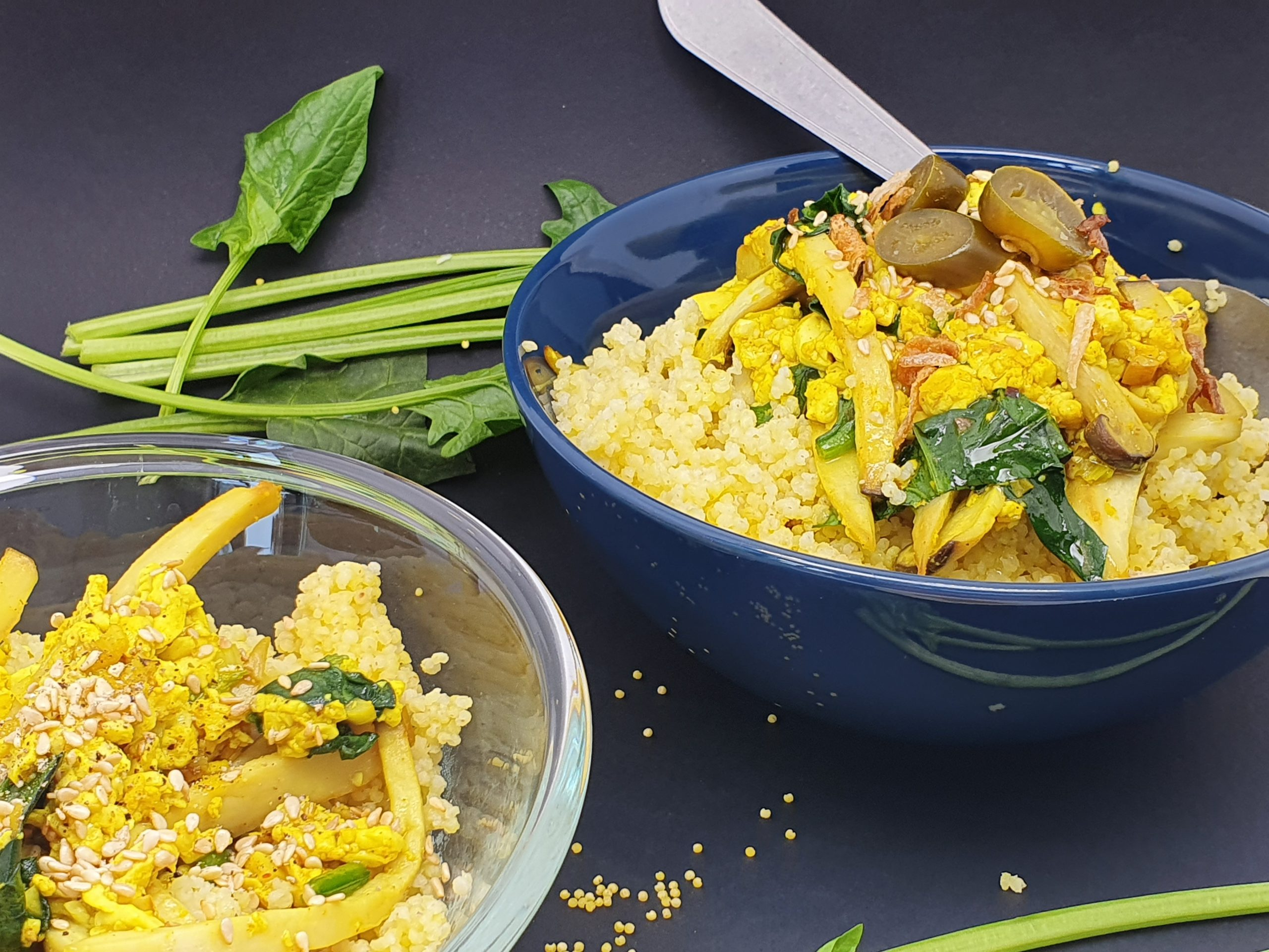 Two bowls with turmeric millet, scramble tofu and mushrooms