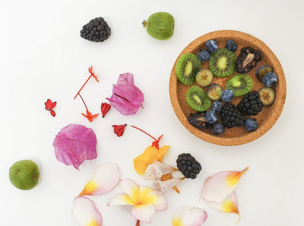 Flowers and berries to top smoothie bowl