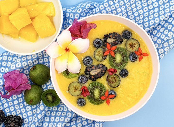 Orange mango smoothie bowl with flowers