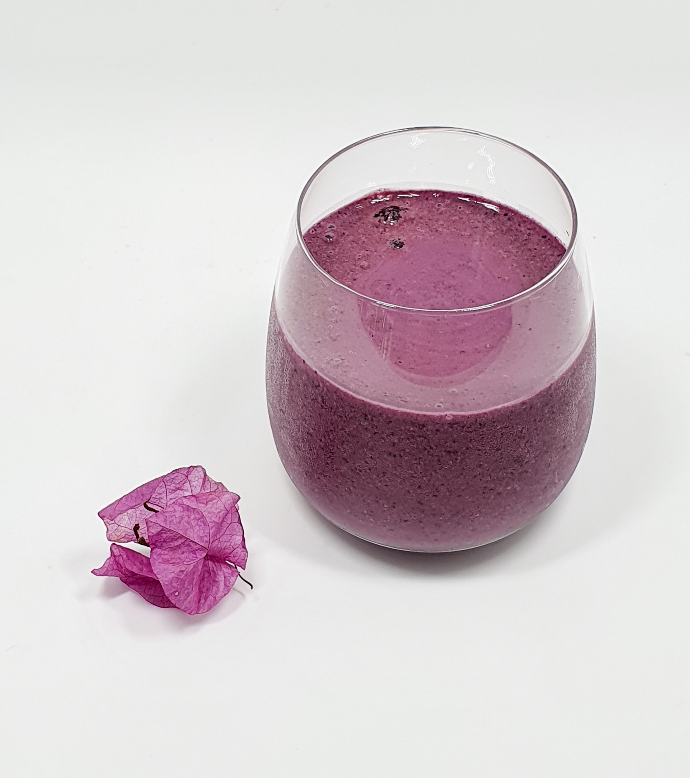 Glass with blueberry oatmeal smoothie